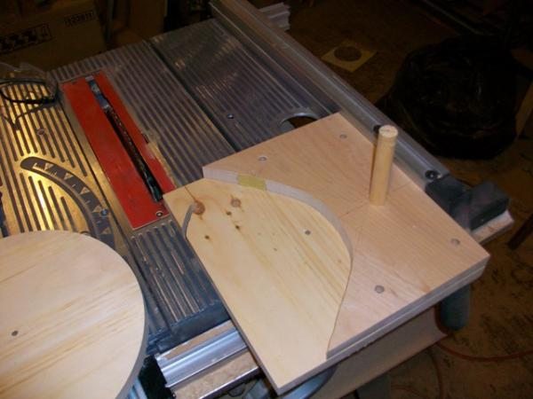 jig for cutting the blanks in half, note pieces of sandpaper to hold the blanks from moving in the jig