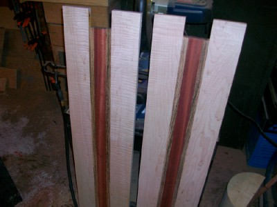 Laminated baffle boards. Bloodwood in the center, Zebra wood on eitherside of that, and Curly (tigerstripe) maple on the outer sides.