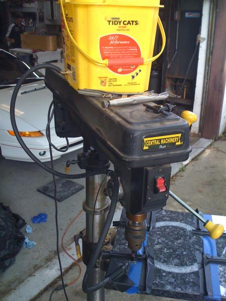 "The set-up: Drill press with 1/2"" diamond core drill bit, gravity fed water feed from bucket. Drillpress set to max RPM"